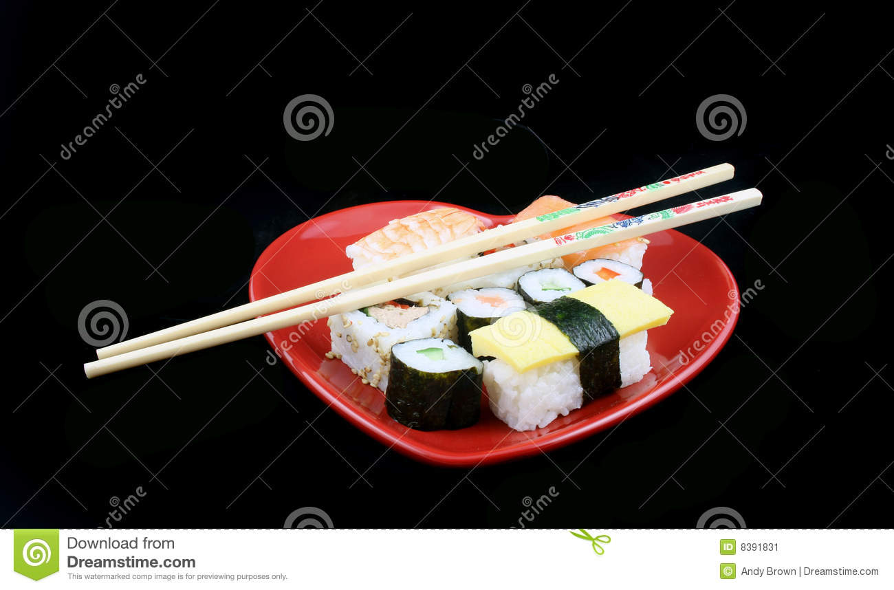 Sushi on a Black Background with chopsticks