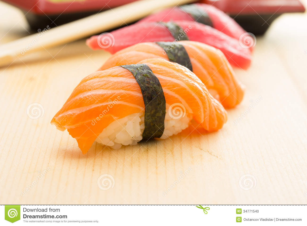 Salmon and tuna sushi nigiri with nori ginger wasabi chopsticks and ...