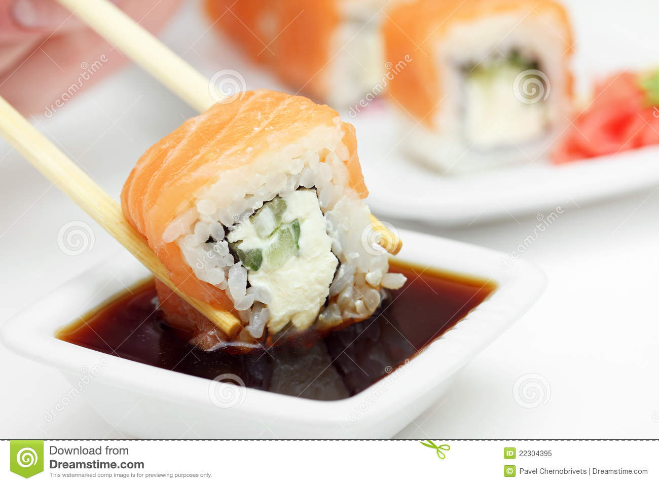 Sushi Roll In Chopsticks In Soy Sauce Stock Image - Image ...