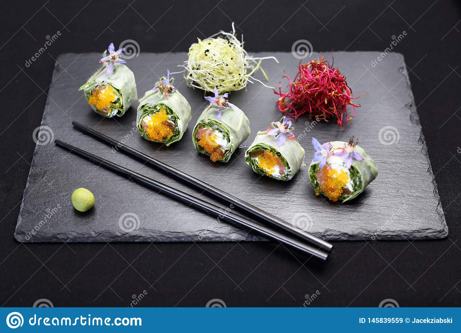 Sushi, sushi rolls with salmon, rucola, philadelphia cheese.