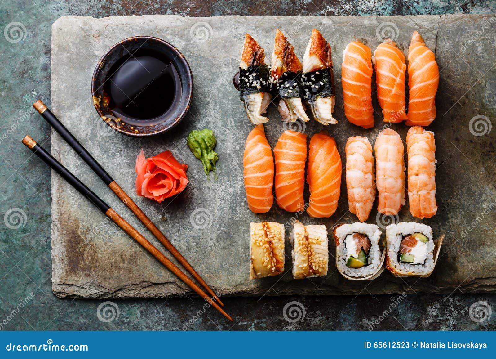 Sushi rolls set on stone slate