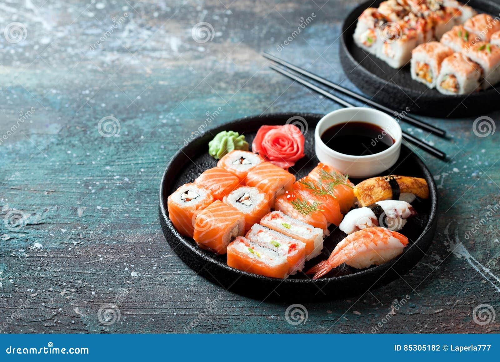 Sushi set nigiri and rolls served in round plate