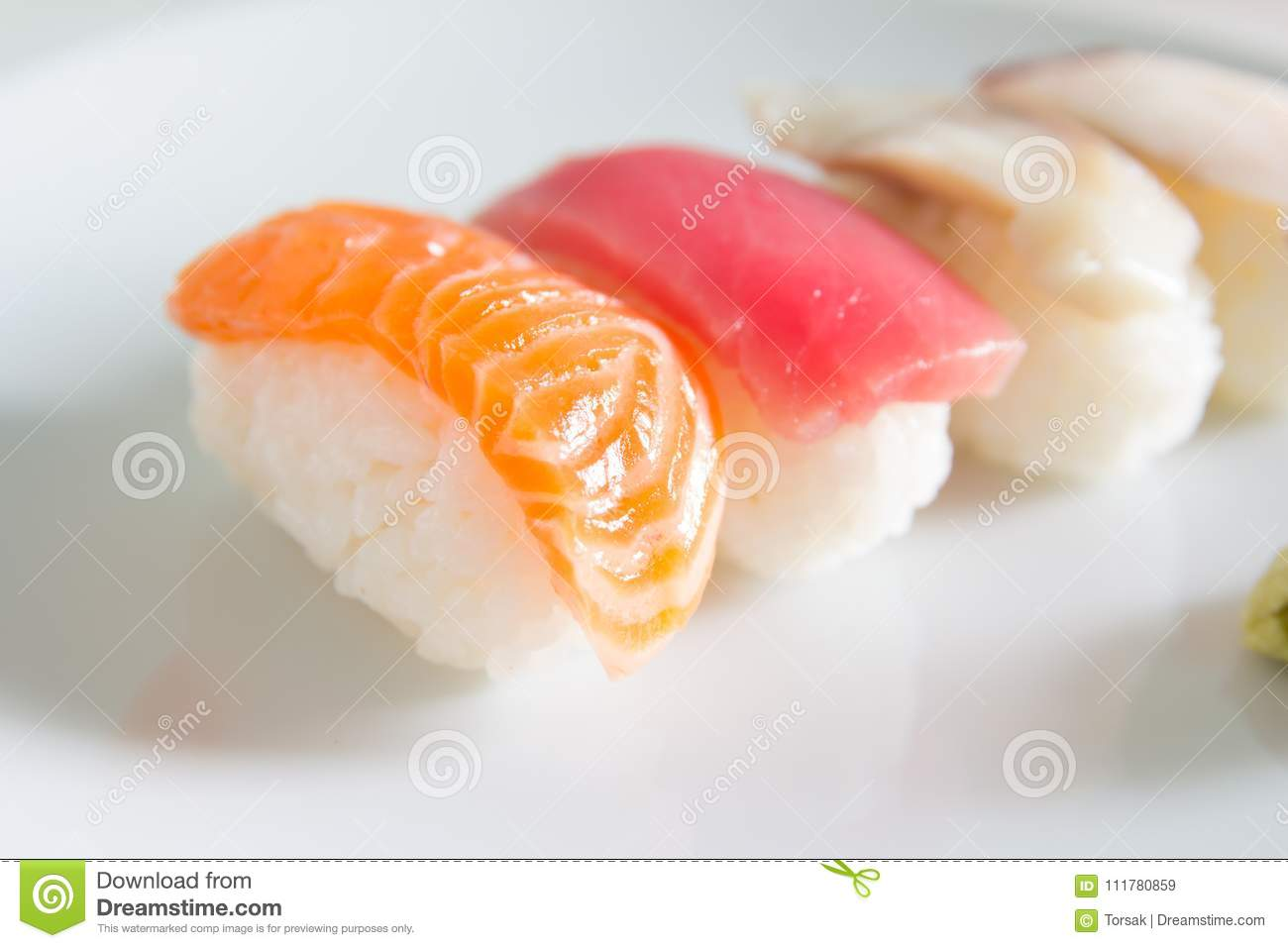 Sushi set on white plate.