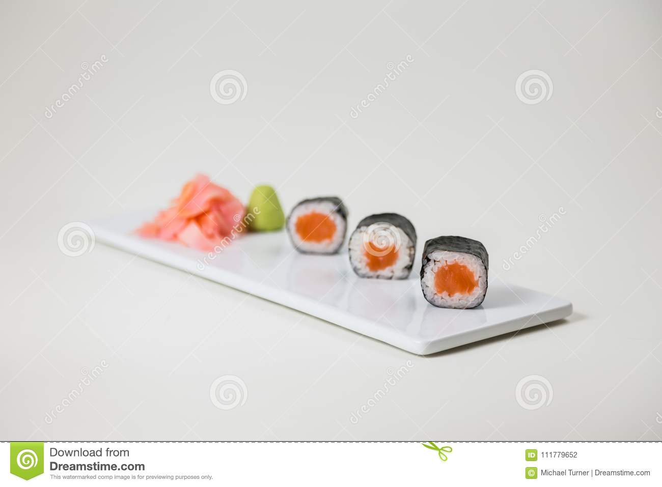 Sushi on a white plate on a white background isolated