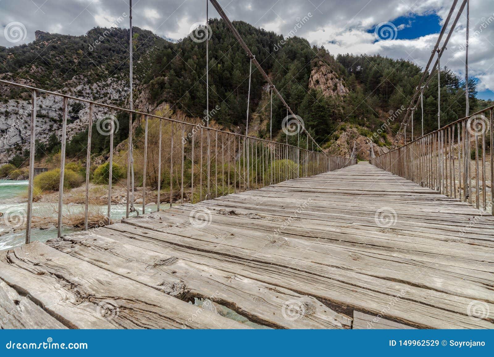Suspension bridge over the wild river