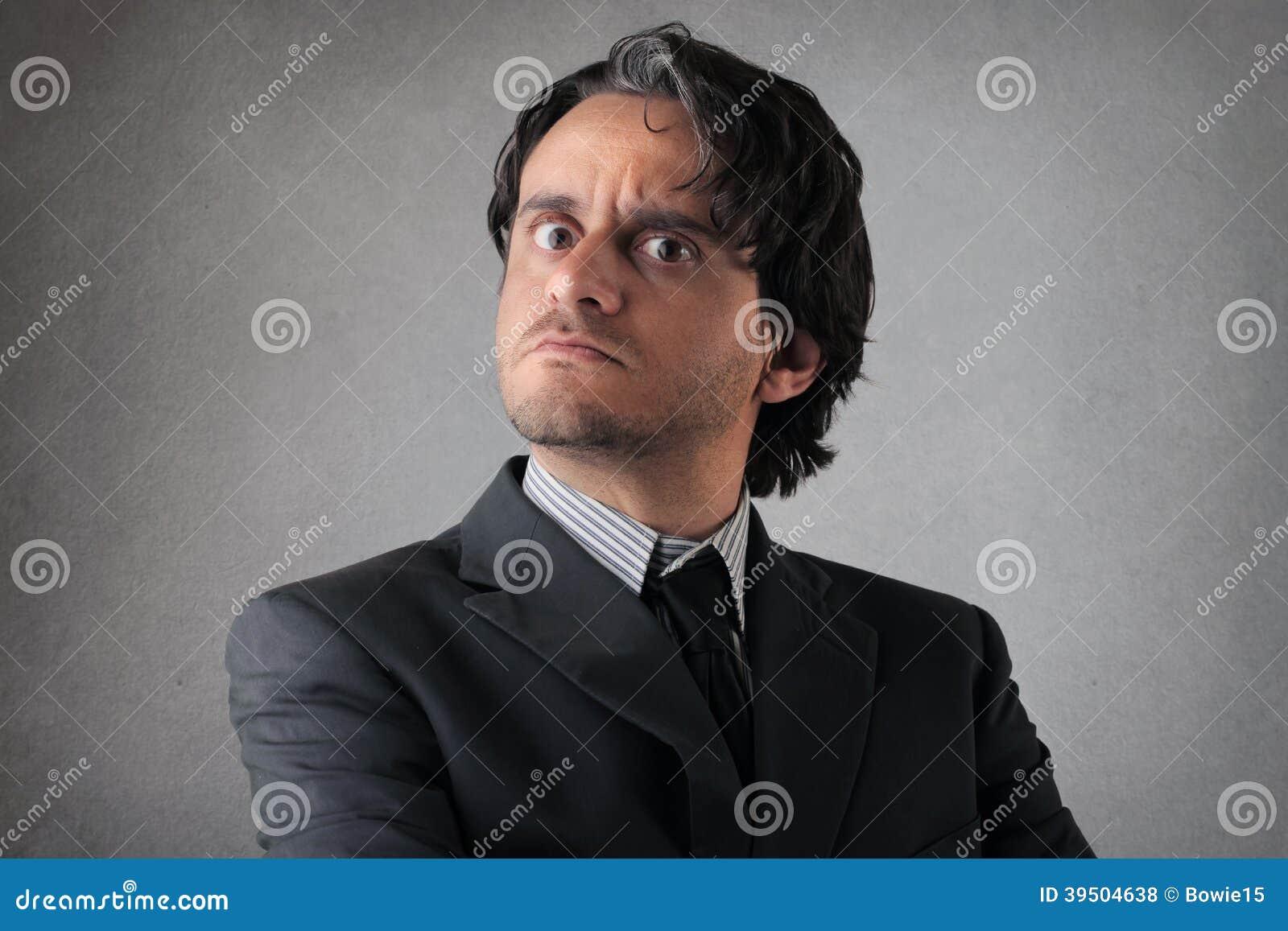 Suspicious young businessman