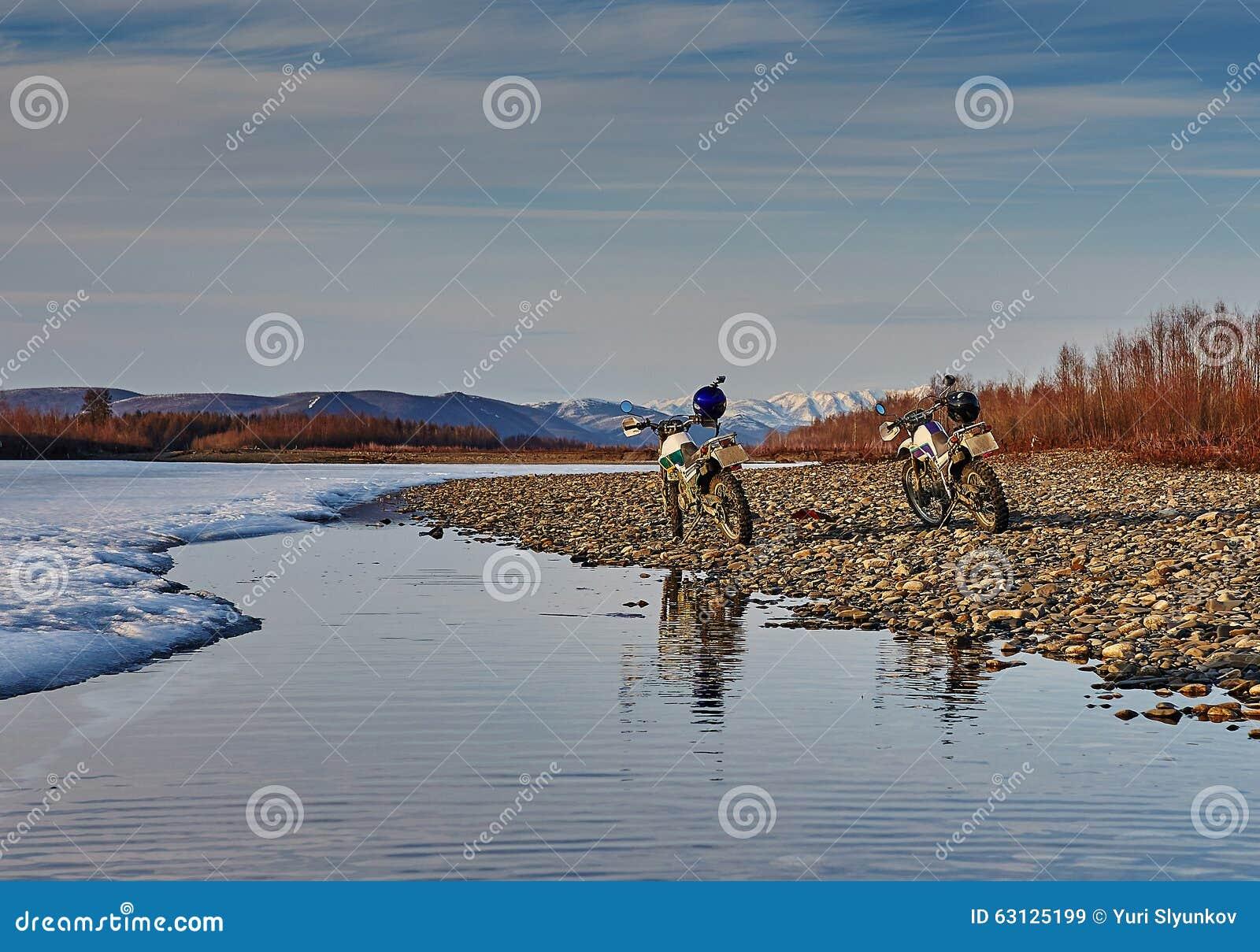 Susuman-Enduro. A motorcycle on river bank