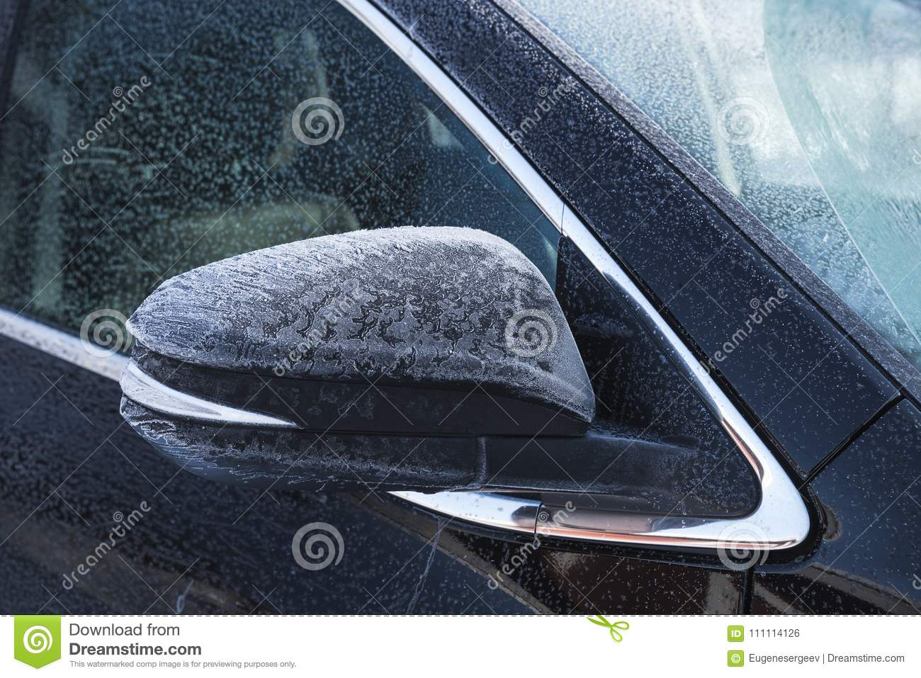 SUV car mirror covered with fresh frost