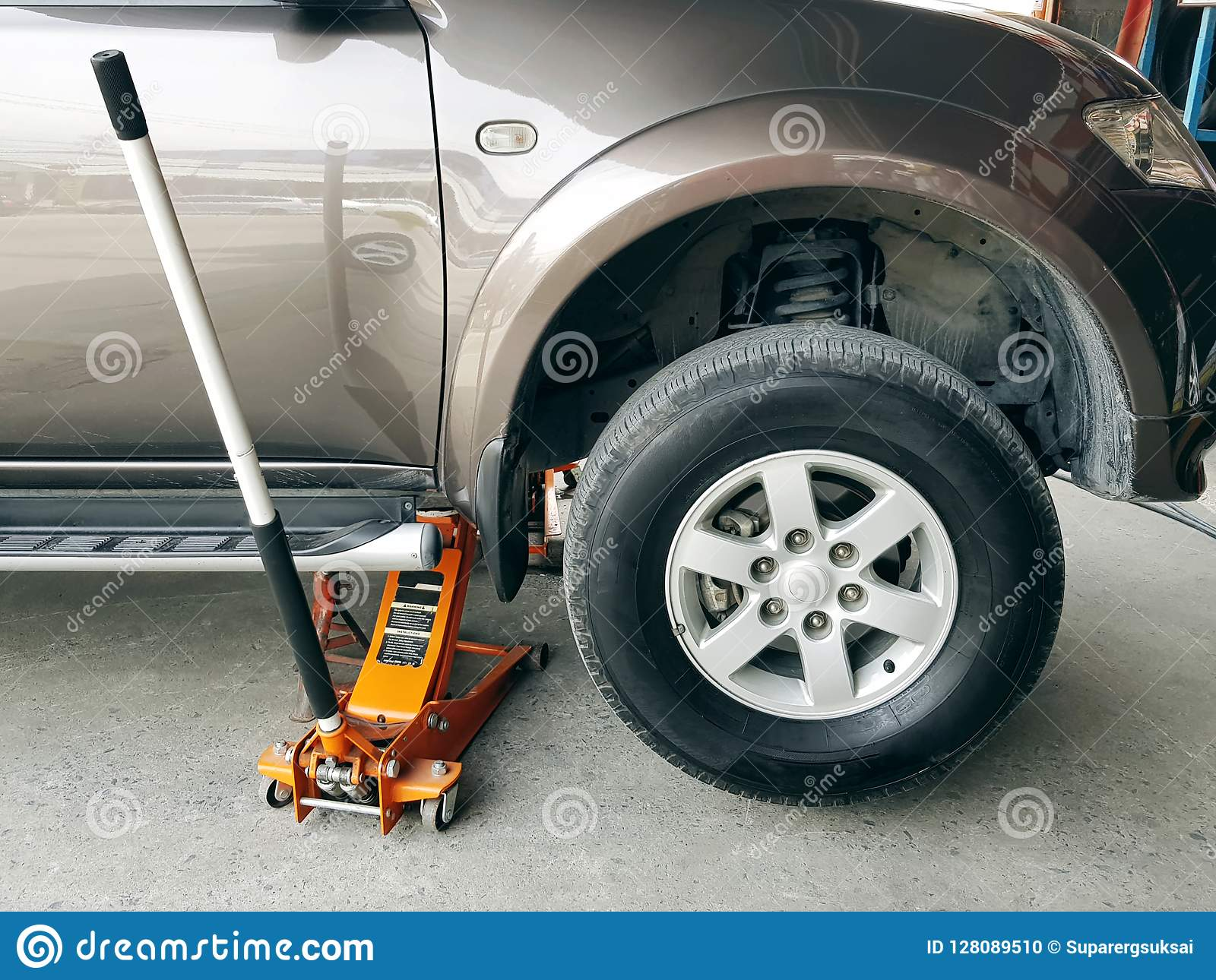 SUV Car Repair, Front Wheel Tyre Changing Stock Photo - Image of