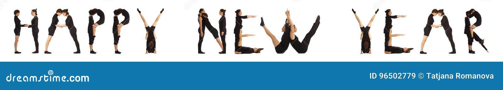 Svärta klätt folk som bildar ord för LYCKLIGT NYTT ÅR