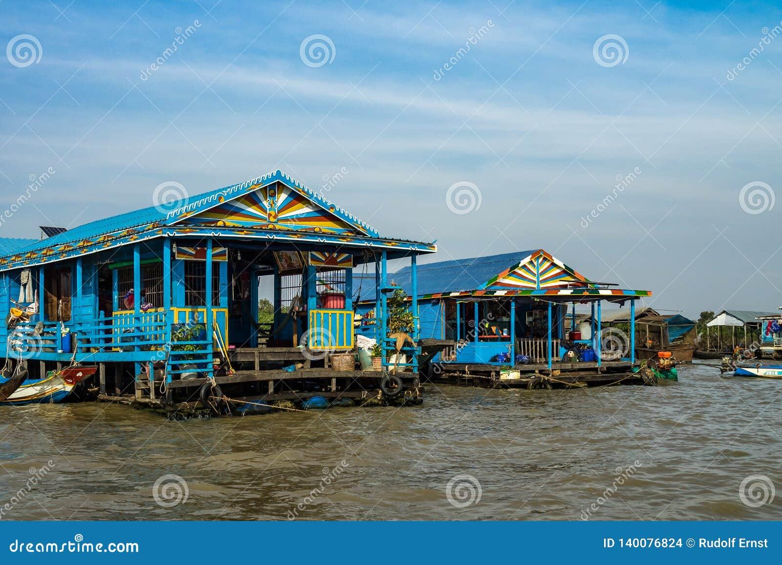 Sväva byn, underminerar Cambodja, Tonle, den Koh Rong ön