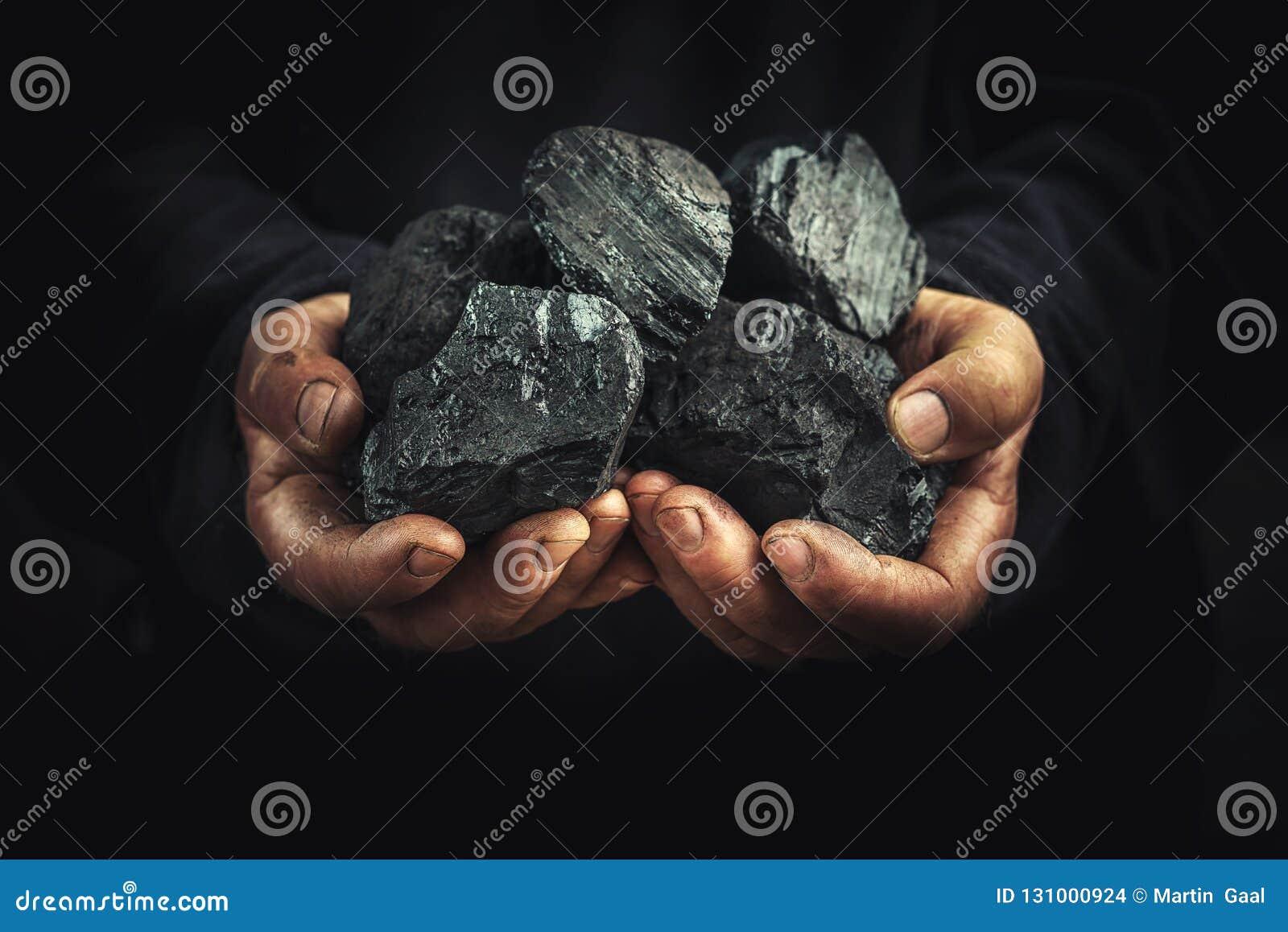 Svart kol i händerna, tung bransch, uppvärmning