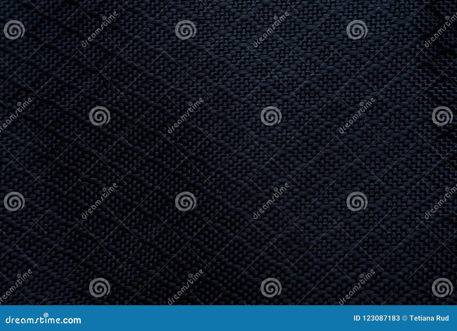 Svart tygtextur för bakgrund Detalj av kanfastextilmaterial