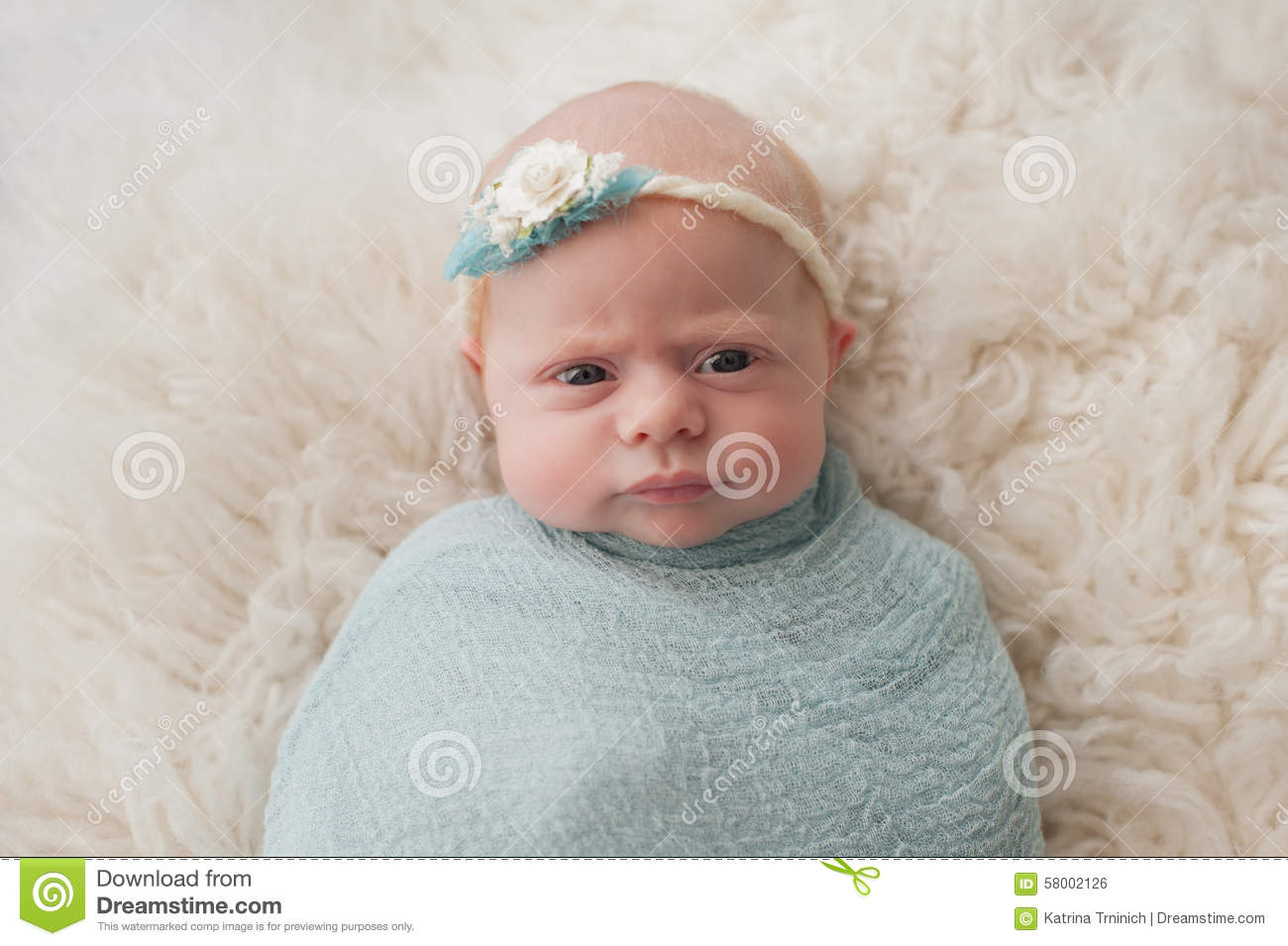 swaddled baby girl with cute expression stock photo - image of cute