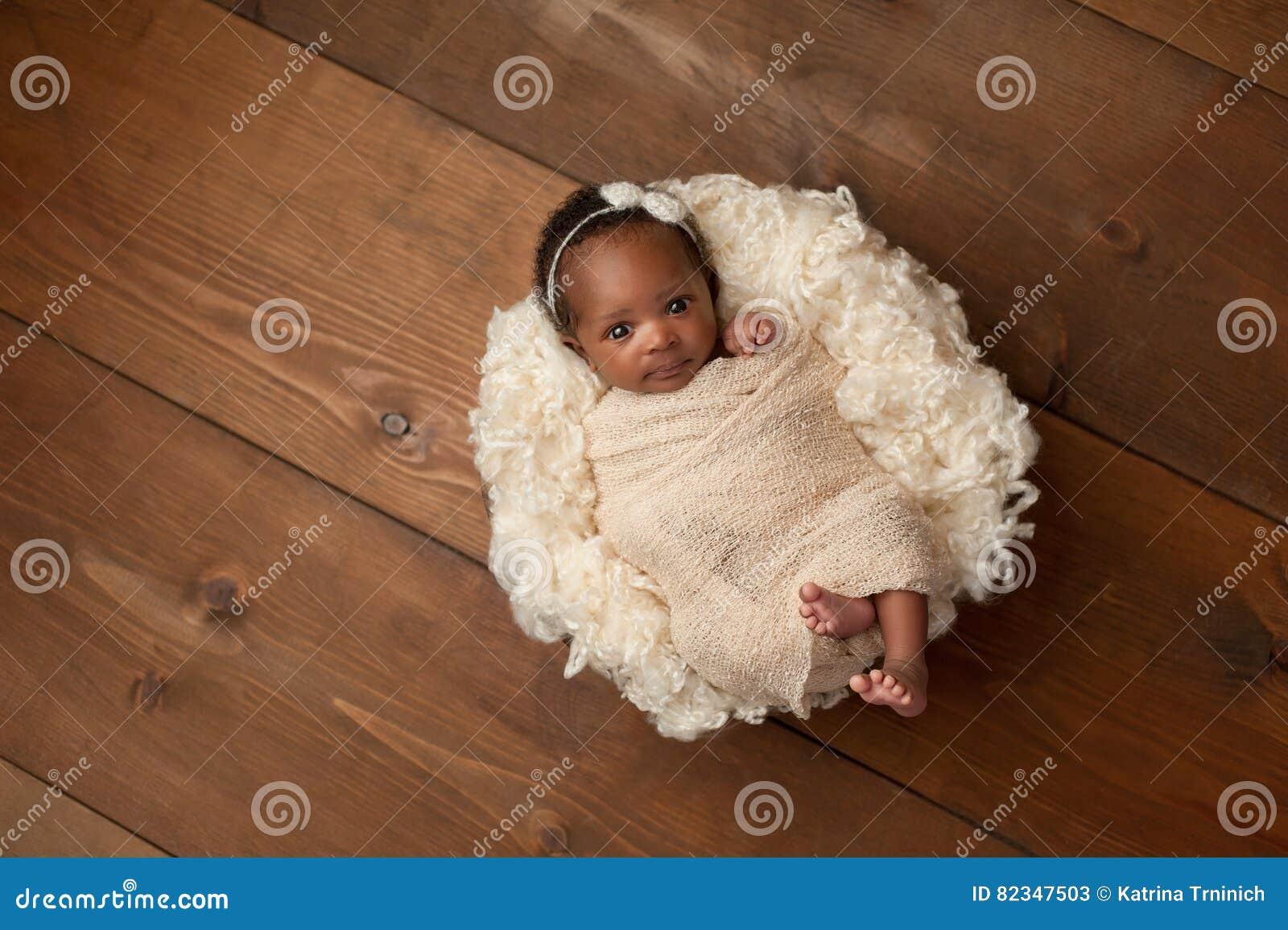 Swaddled Newborn Baby Girl