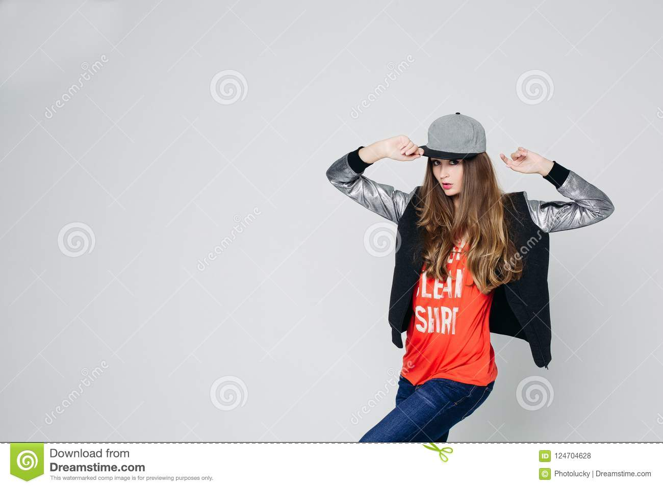 Swag Stylish Teenage Girl In Cap Posing With Hands Up Stock