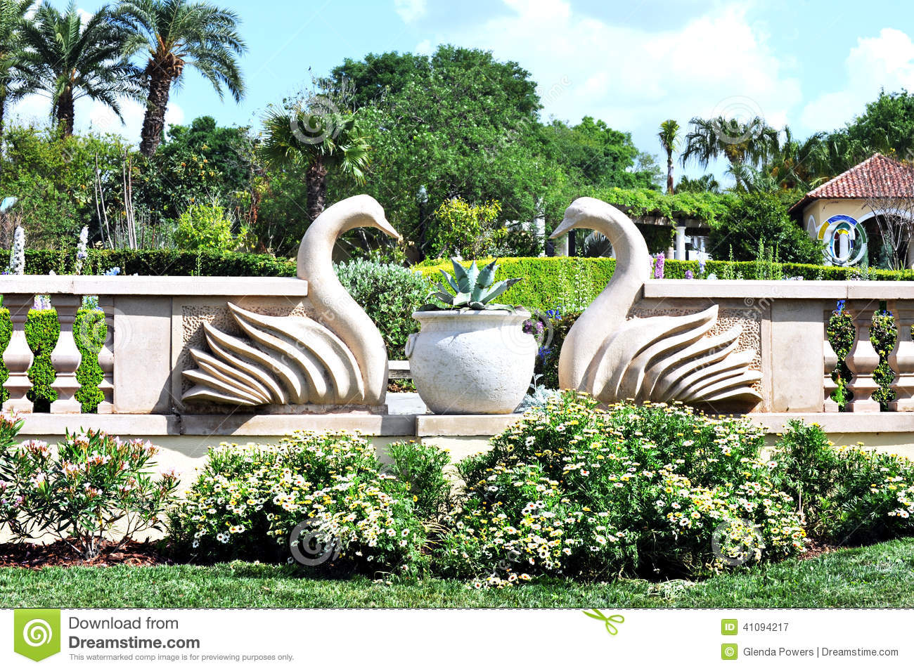 Swans Statues In A Tropical Garden