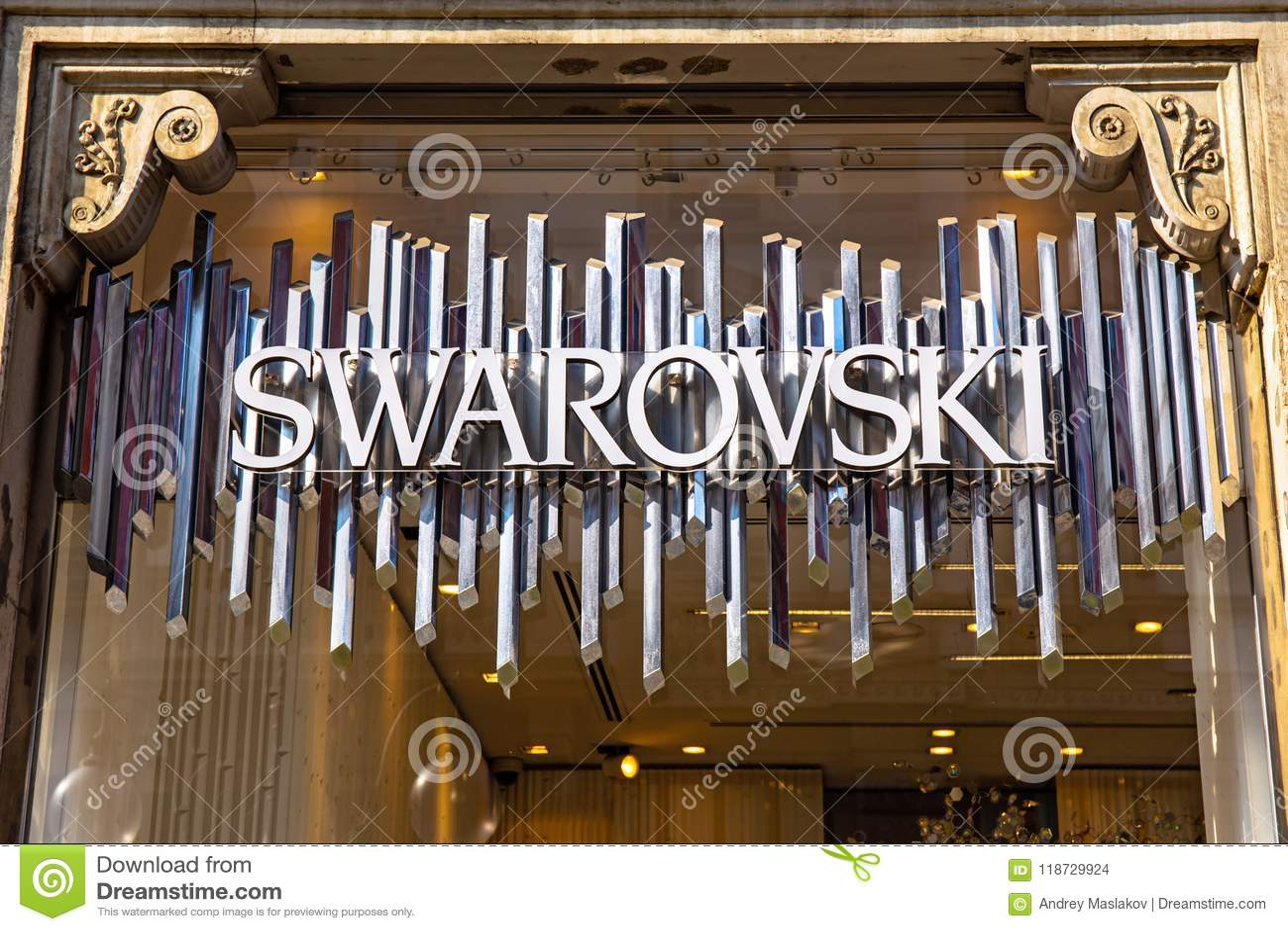 bbf527cc8ce MILAN, ITALY - APRIL 07, 2018: Swarovski store sign in Milan. Swarovski is  an Austrian producer of cut lead glass, headquartered in Wattens, Austria.