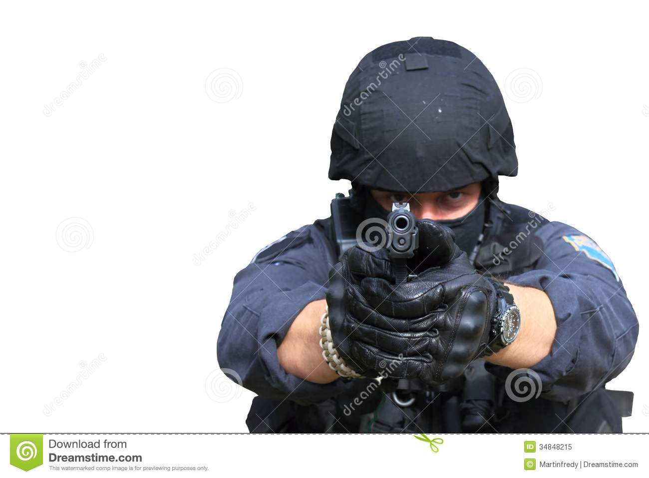 Swat police officer pointing a gun at the camera, isolated on white