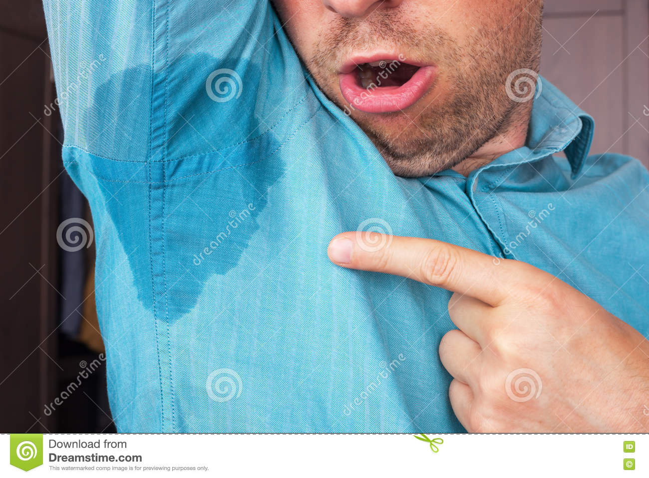 Sweaty armpit stock photography 51927608 for How to keep your armpits from sweating through your shirt