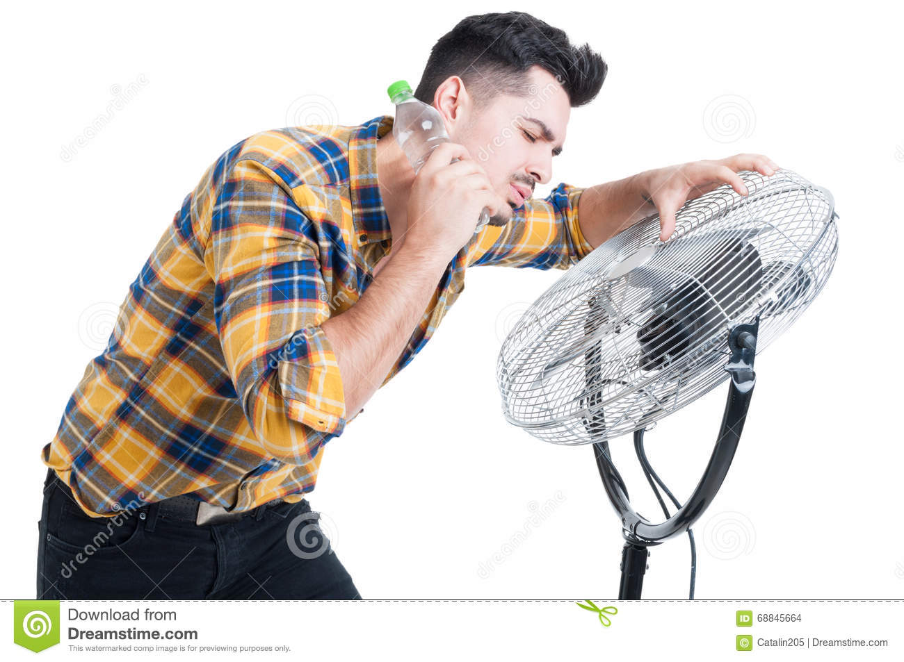 Cooling Off With Fan : Sweaty and thirsty man standing near fan cooling off