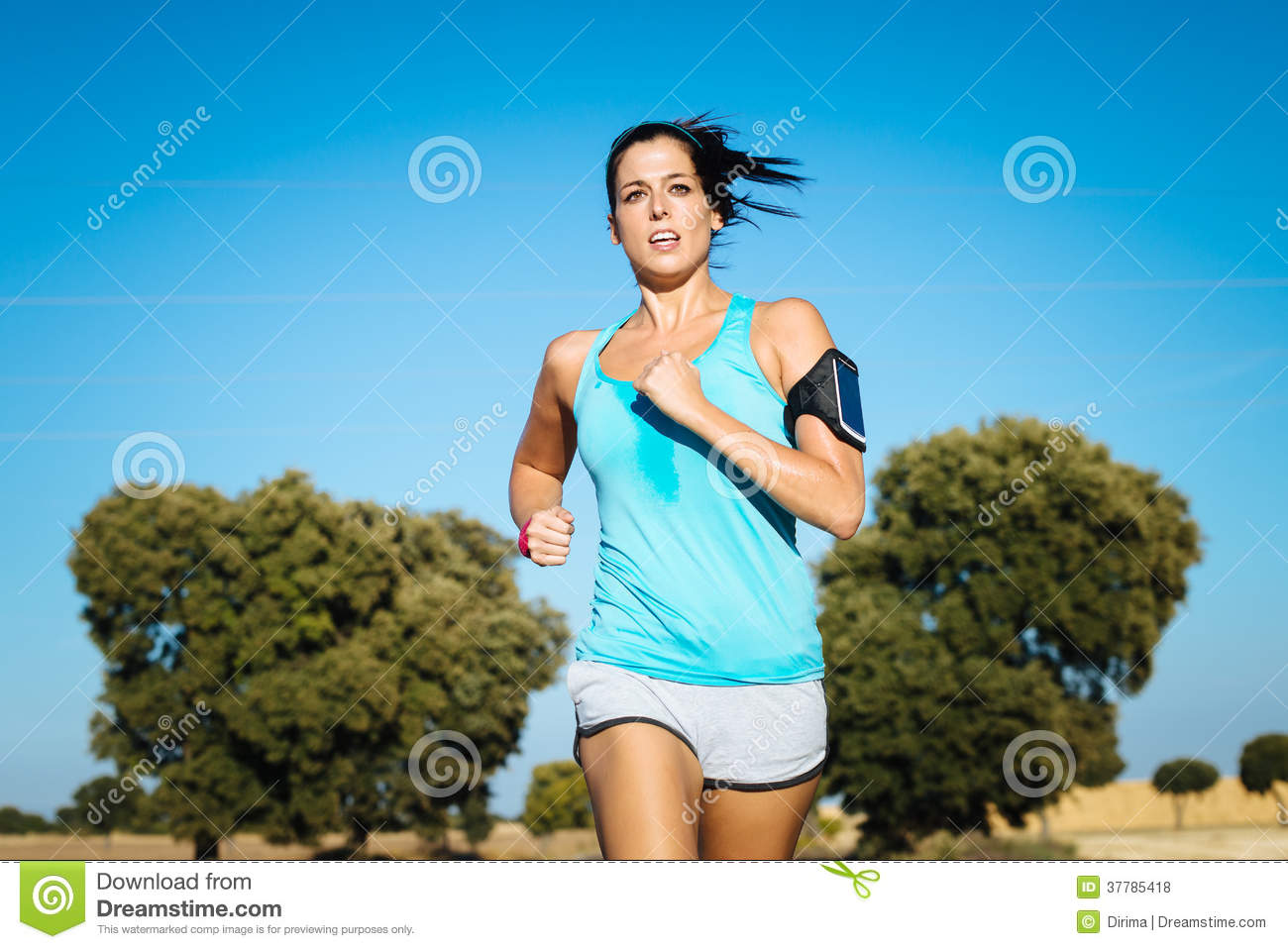 Sweaty woman running cross trail