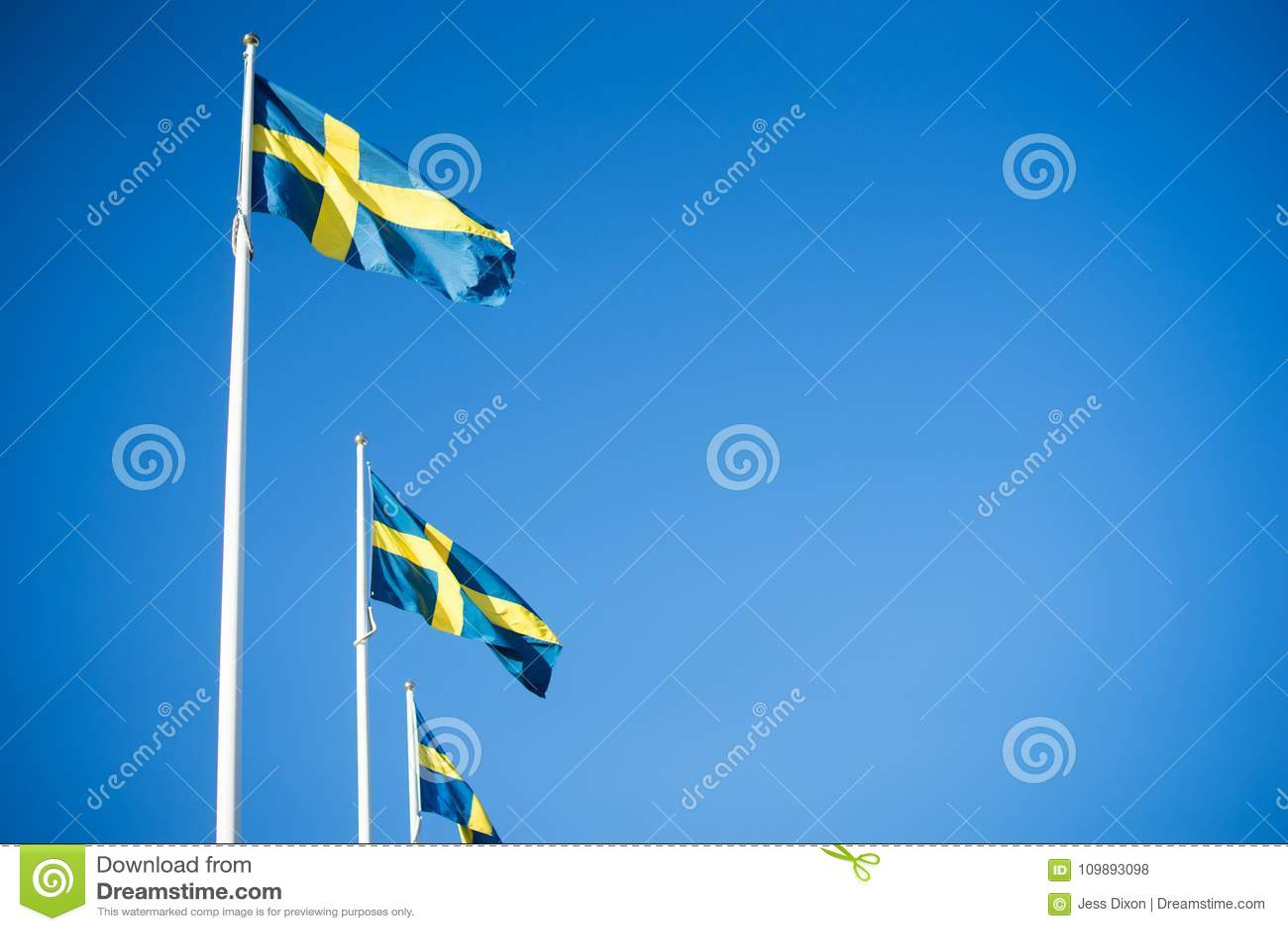 Swedish Flags in clear blue sky - Gothenburg, Sweden