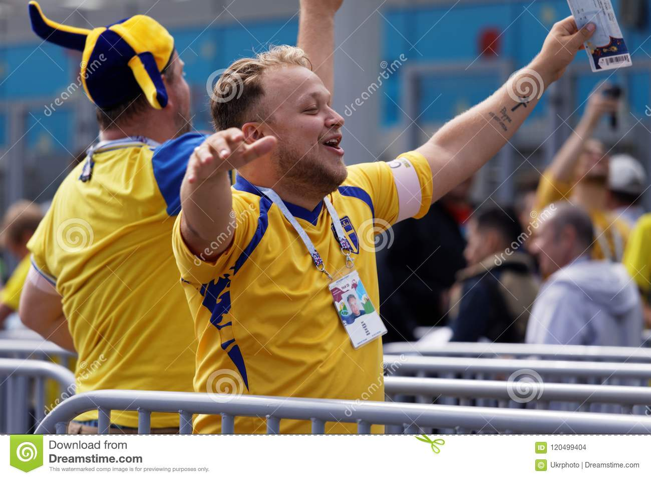 d4f4f4958b8 St. Petersburg, Russia - July 3, 2018: Swedish football fans singing at  Saint Petersburg stadium before the match of FIFA World Cup 2018 Sweden vs  ...