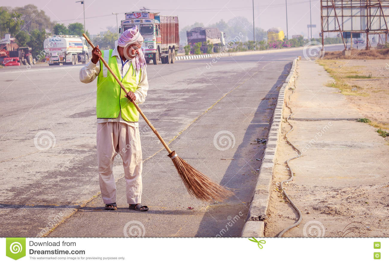 Sweeper Cleaning The Road With Broom Stock Photo Image