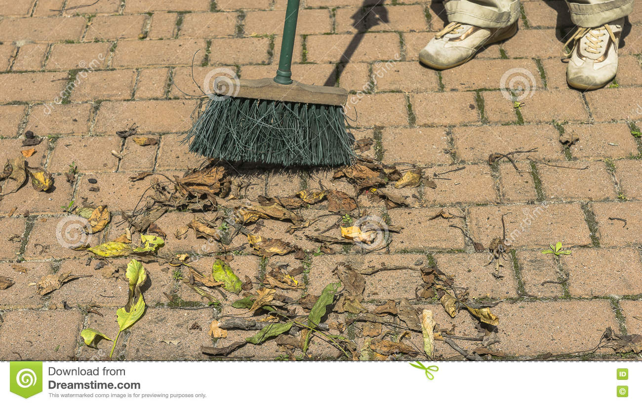 Sweeping leaves a broom stock photo. Image of outside - 75358010