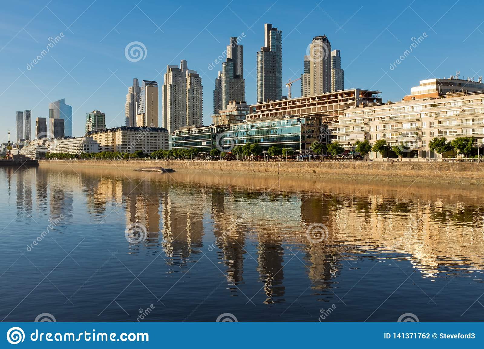 Sweeping view along the Rio de la Plata of the Perto Madero district of Buenos Aires, Argentina with reflections of the modern