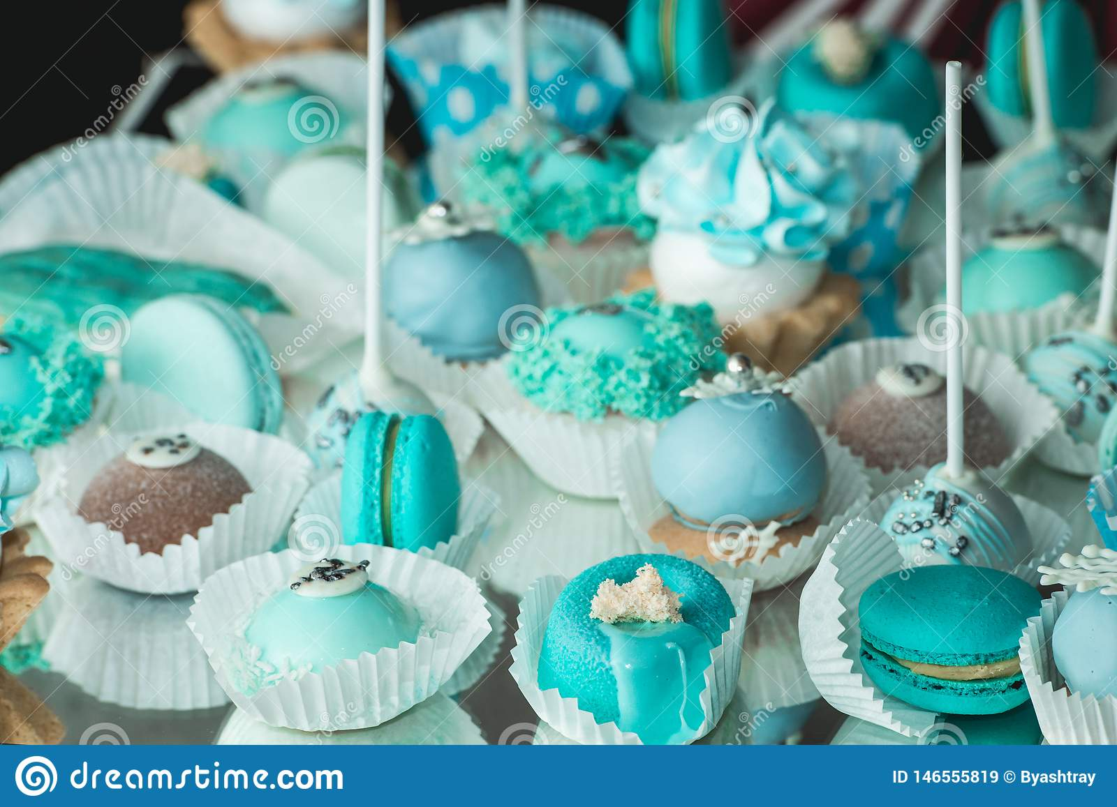 Sweet almond colorful tiffany colored blue macaron or macaroon dessert cake. French sweet cookie. Minimal food bakery concept
