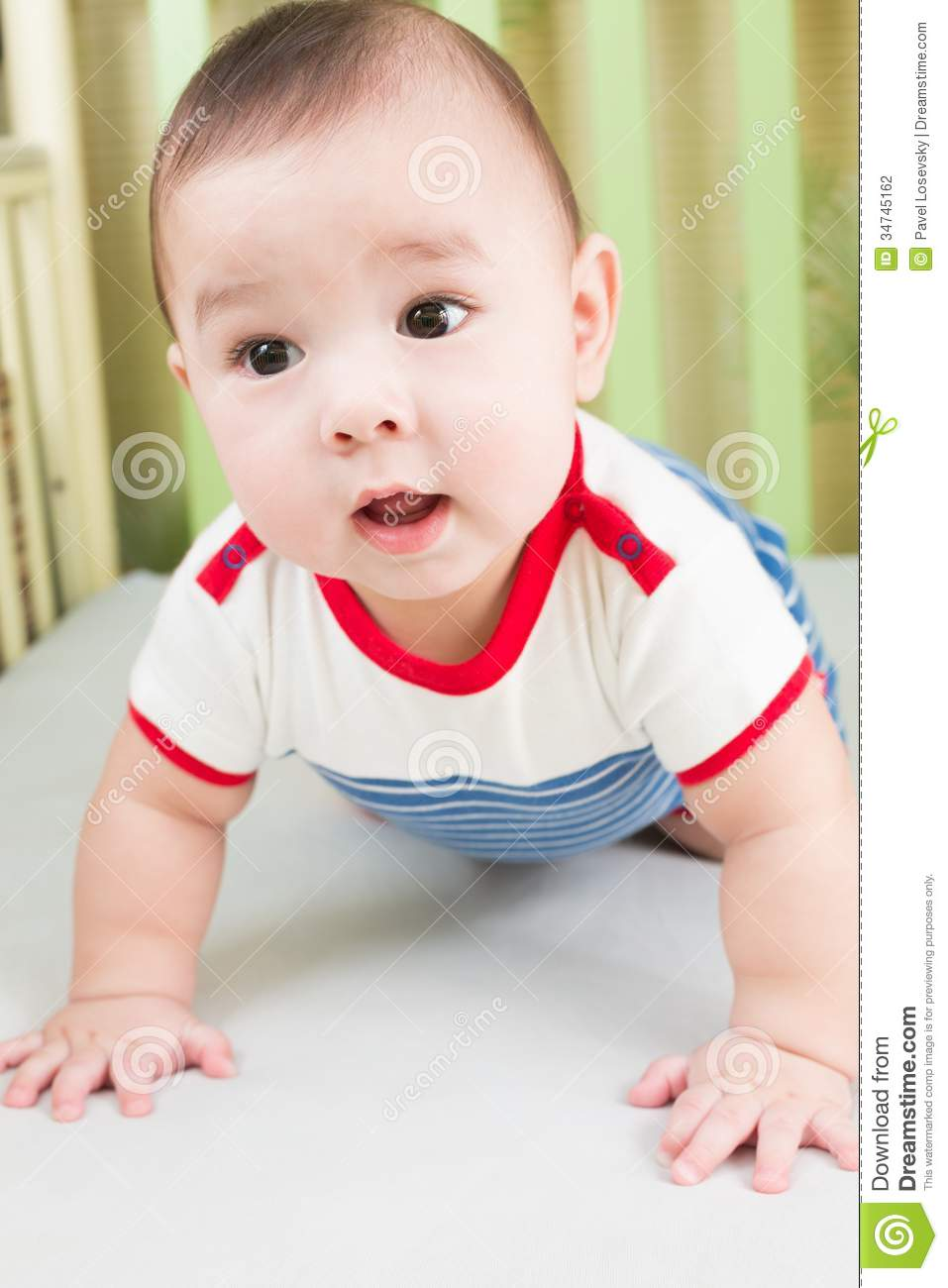 sweet baby boy in striped clothes stock photo - image of fence, hand