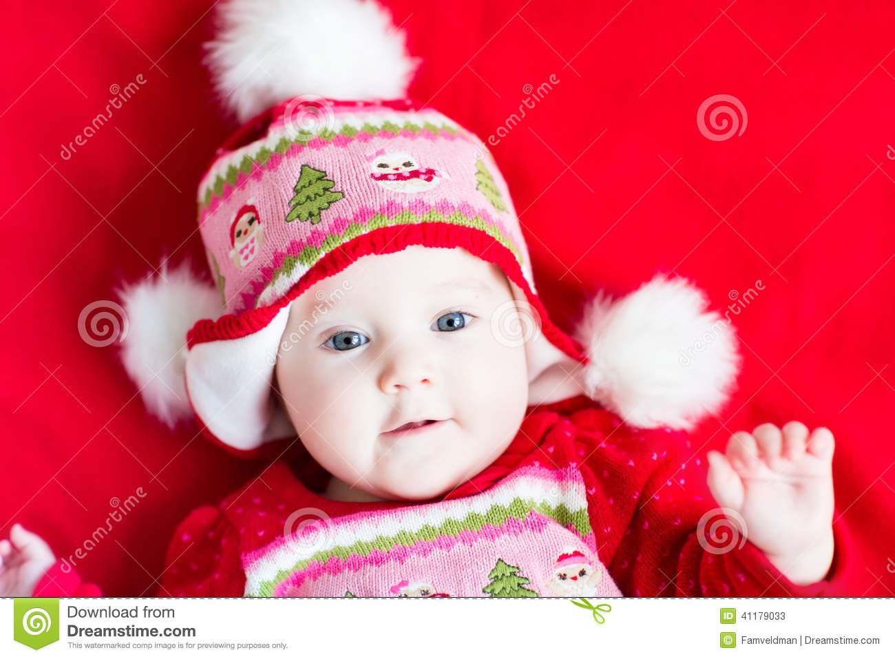 Sweet Baby Girl In A Christmas Knitted Dress And Hat Stock ...