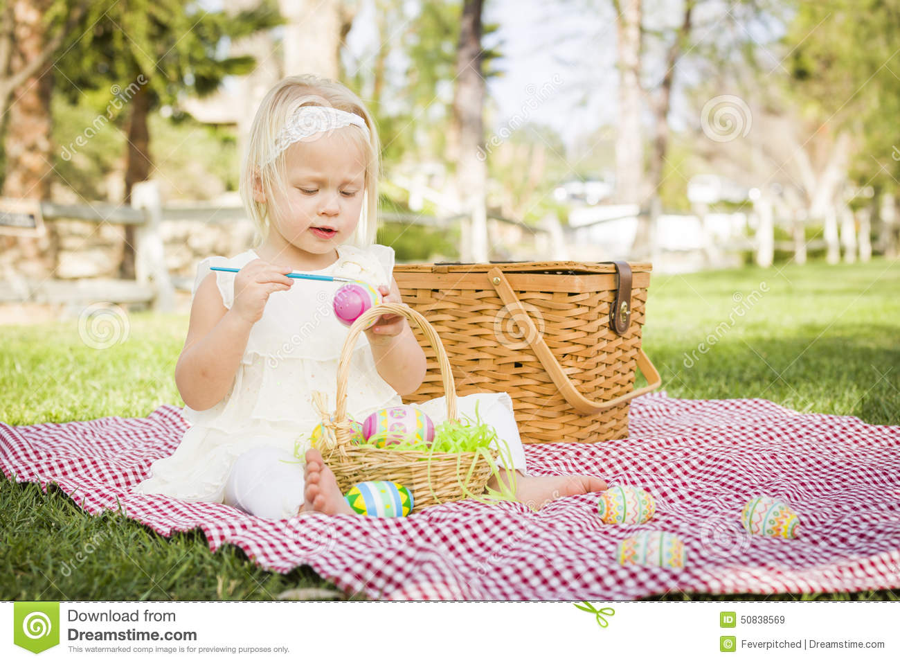 Sweet baby girl coloring easter eggs on picnic blanket for Picnic blanket coloring page