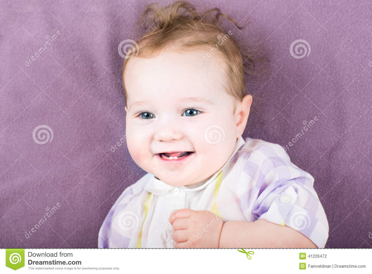 sweet baby girl in a purple dress on purple background
