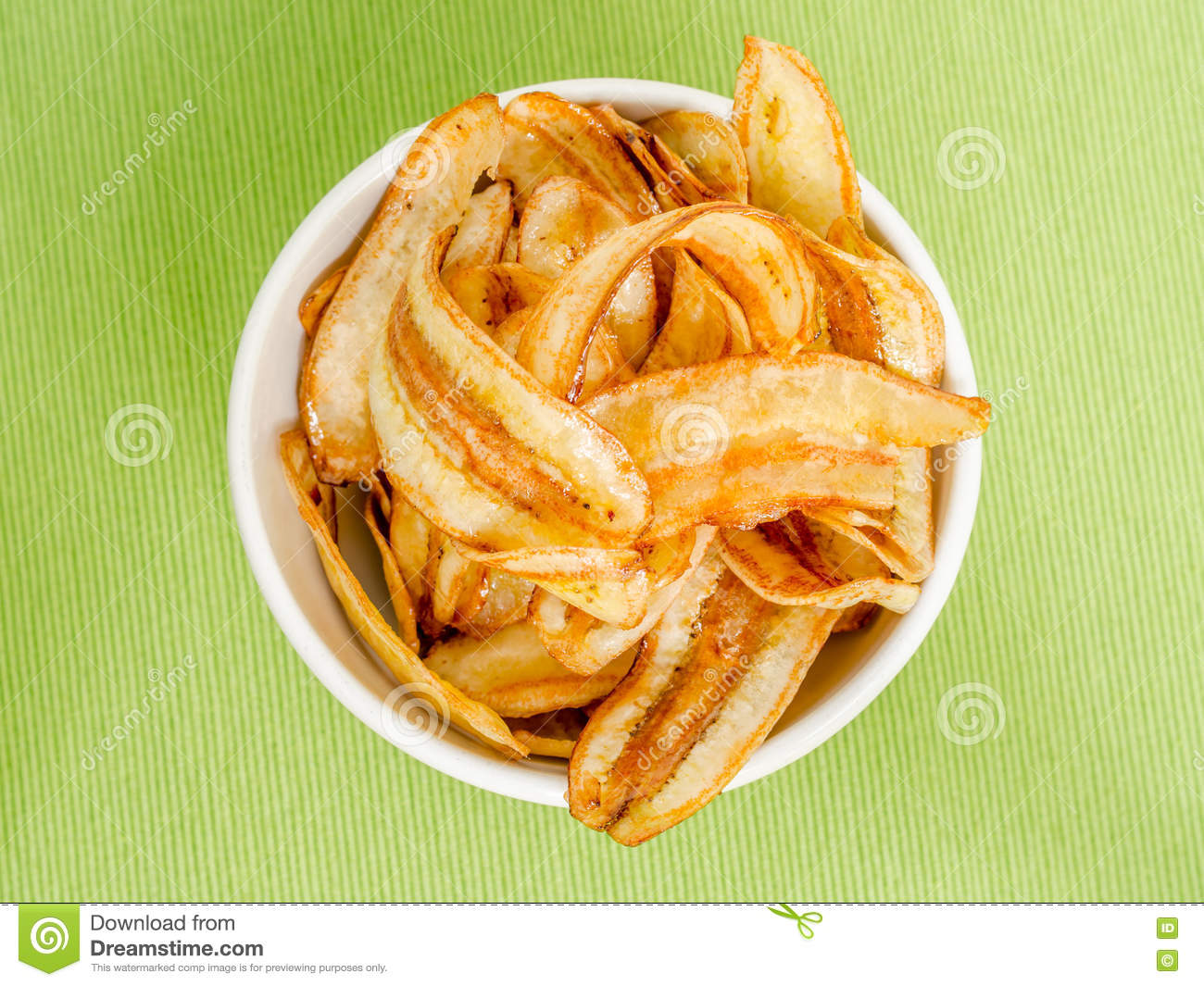 Sweet Banana Chips On Green Table Cloth Background Stock
