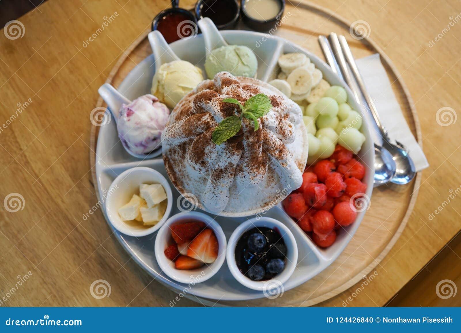 Sweet bingsu korean desert with fruits, melon, strawberries, blueberries, watermelon, icecream