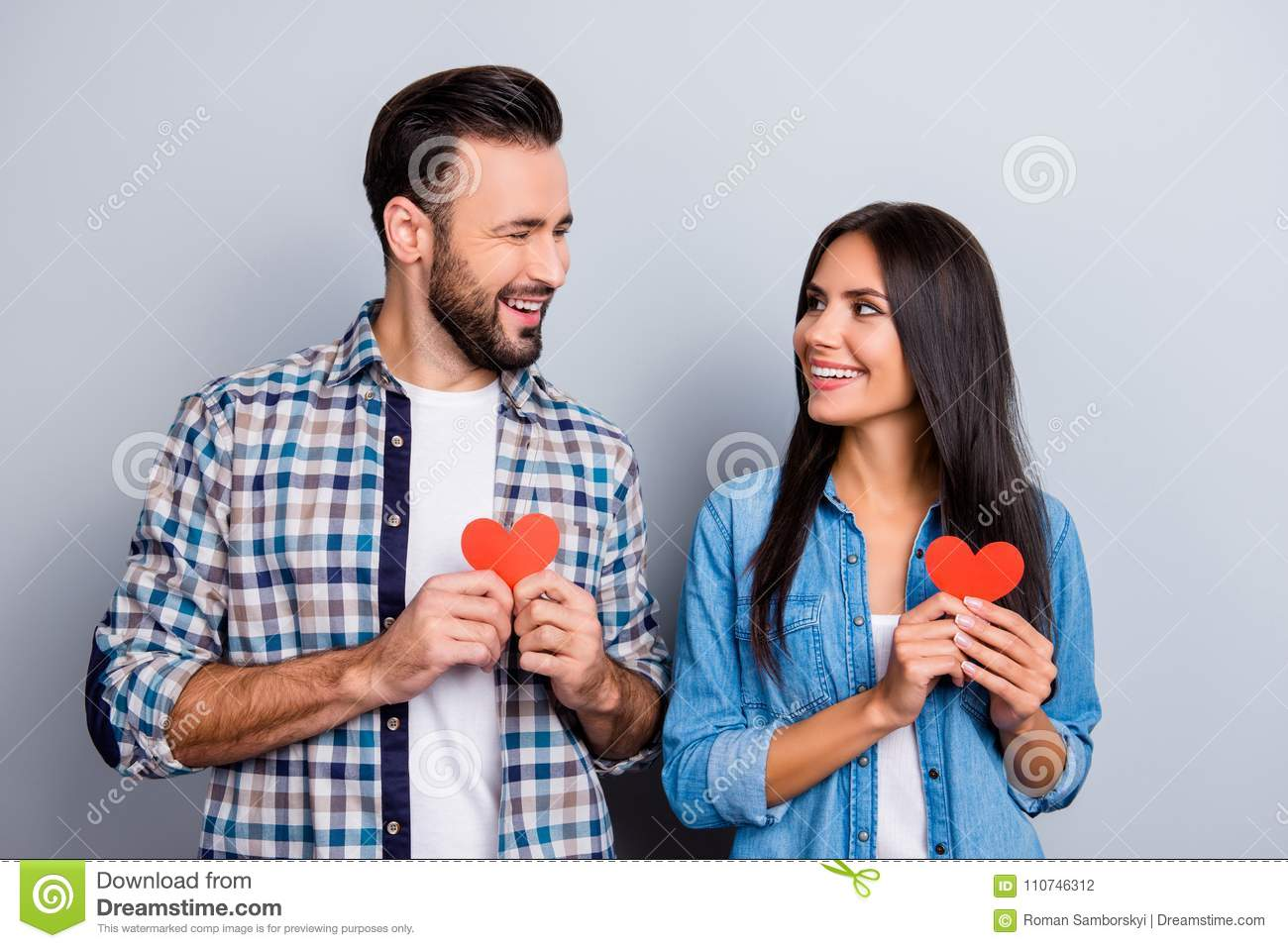 Sweet Cheerful Positive Smiling Couple In Shirts Holding Small
