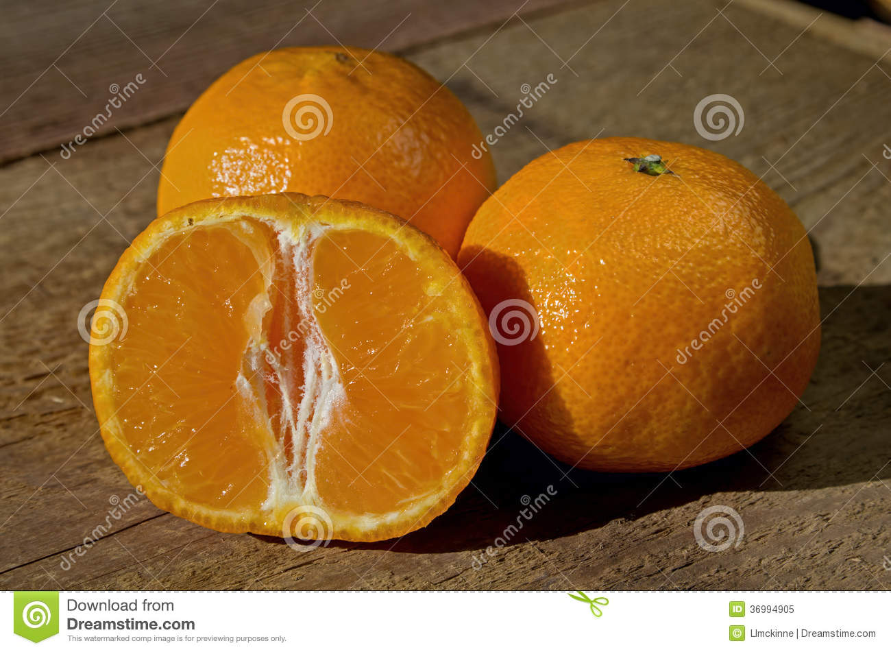 between a mandarin and an orange the skin is a deep orange color