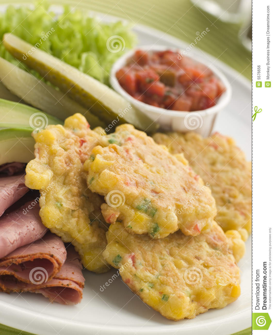 Sweet corn Fritters with Salsa Gherkins Avocado
