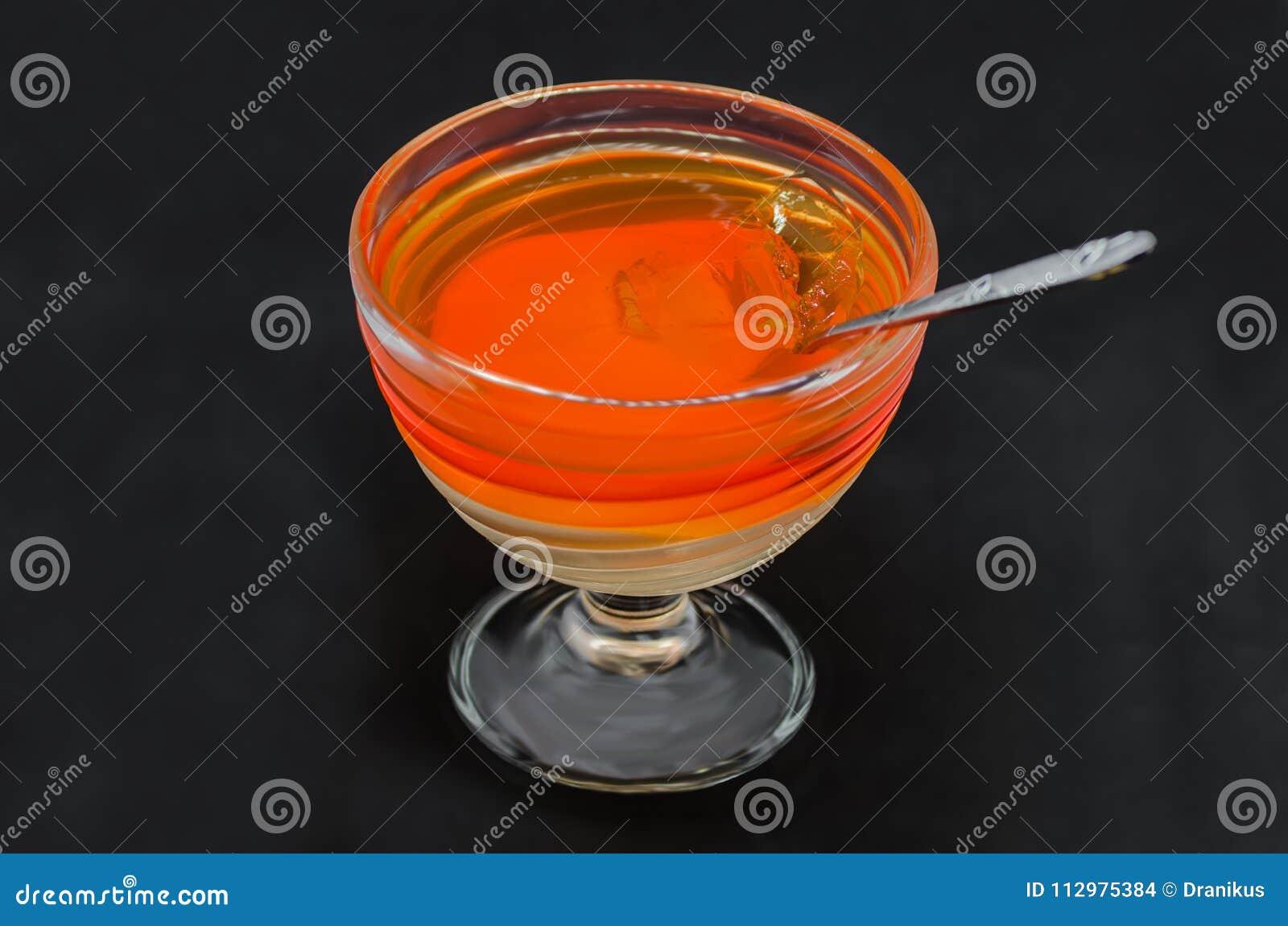 Sweet delicious dessert of multi-colored jelly in a glassware