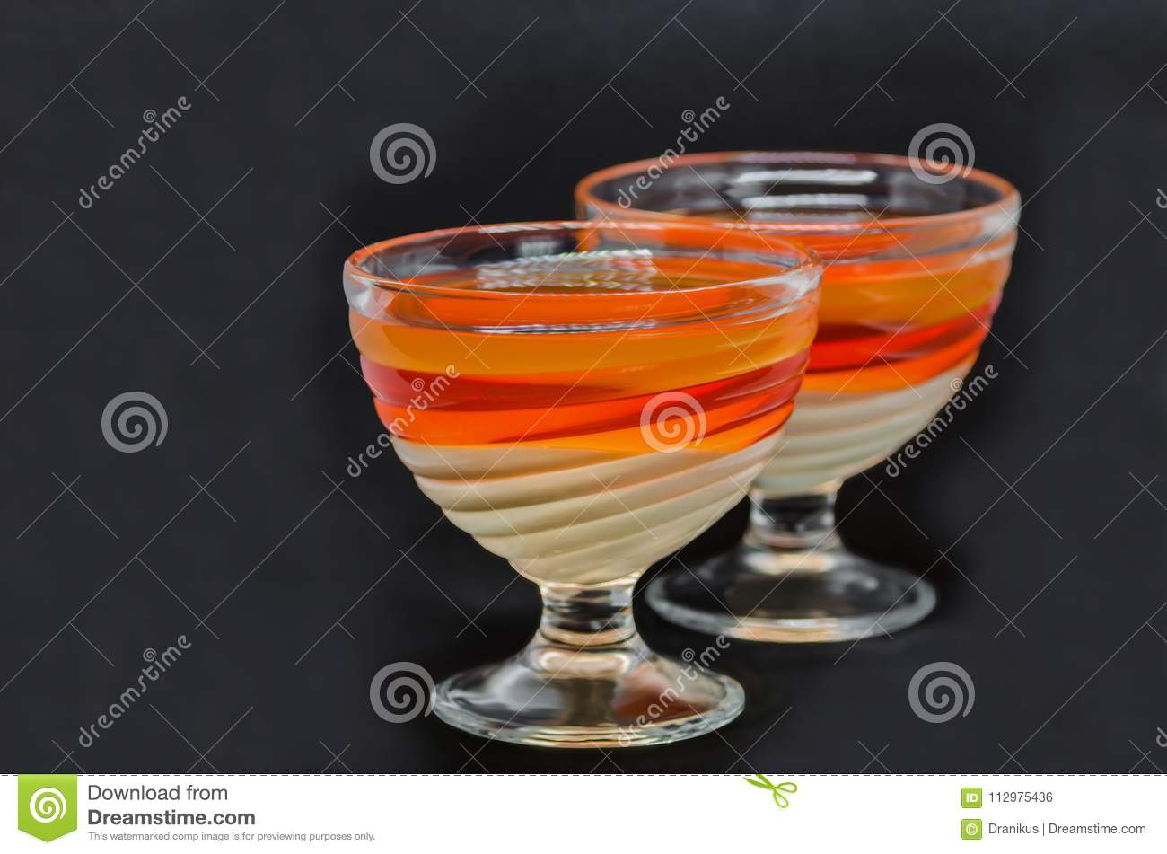 Sweet delicious dessert of multi-colored jelly in a glassware