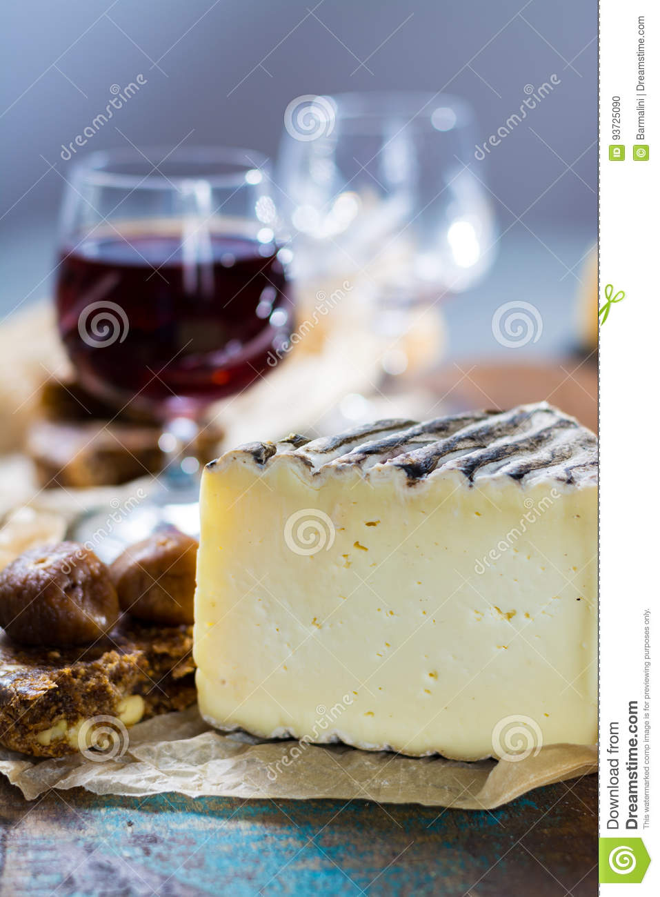 Sweet dessert liqueur wine in glass, hard french cheese Tomme de