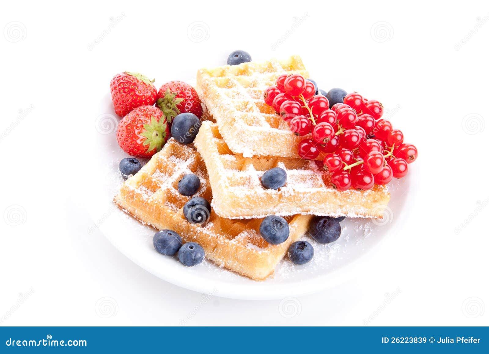 Sweet fresh tasty waffles with mixed fruits