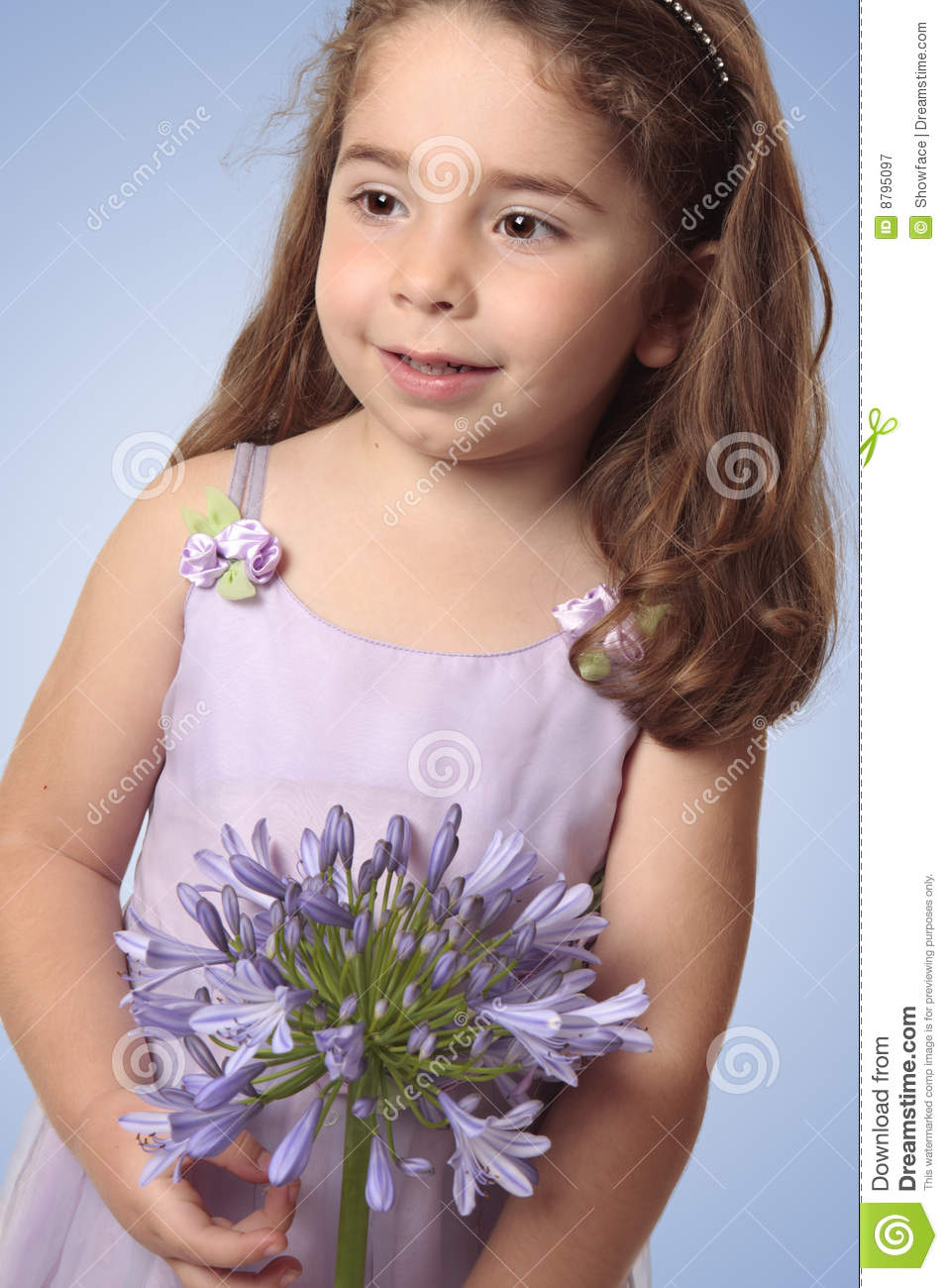 Sweet girl with lily flower royalty free stock photography image agapanthus flower girl holding lily dhlflorist Choice Image