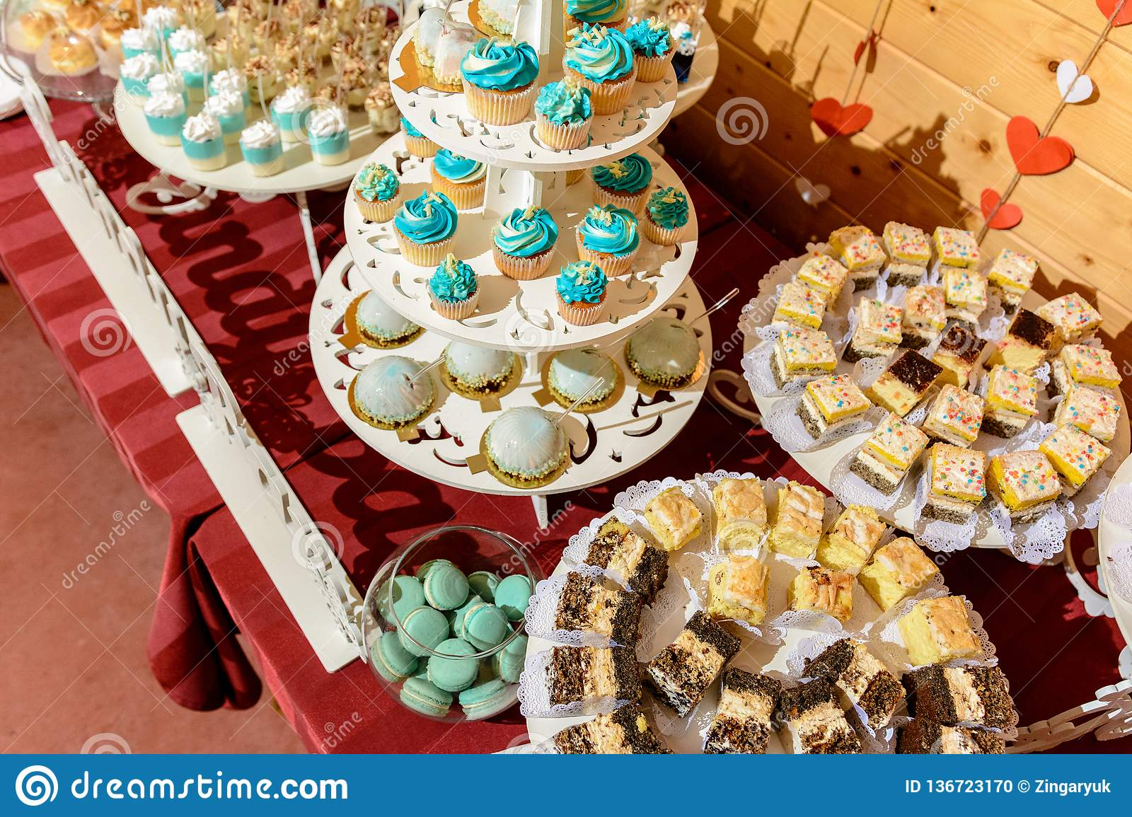 Sweet gourmet buffet table at the wedding in blue tones