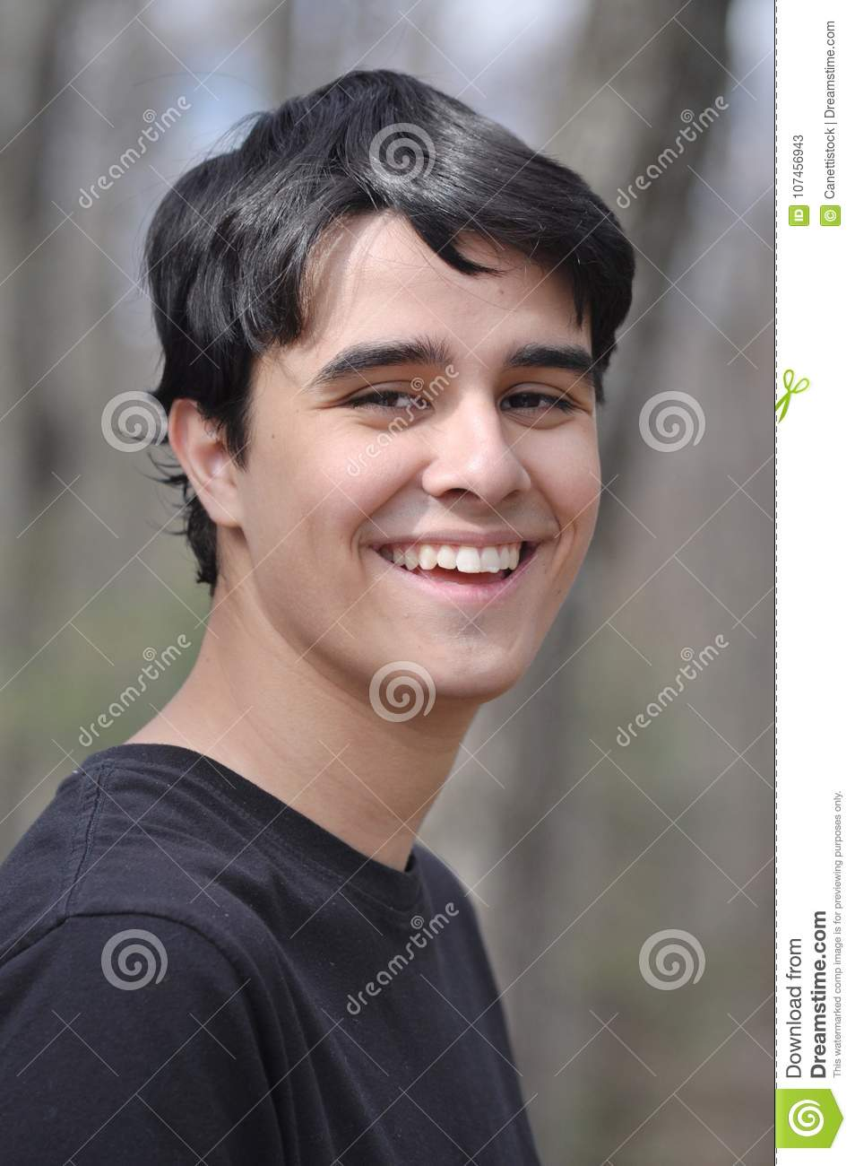 Sweet and Handsome high-school boy smiling to the camera