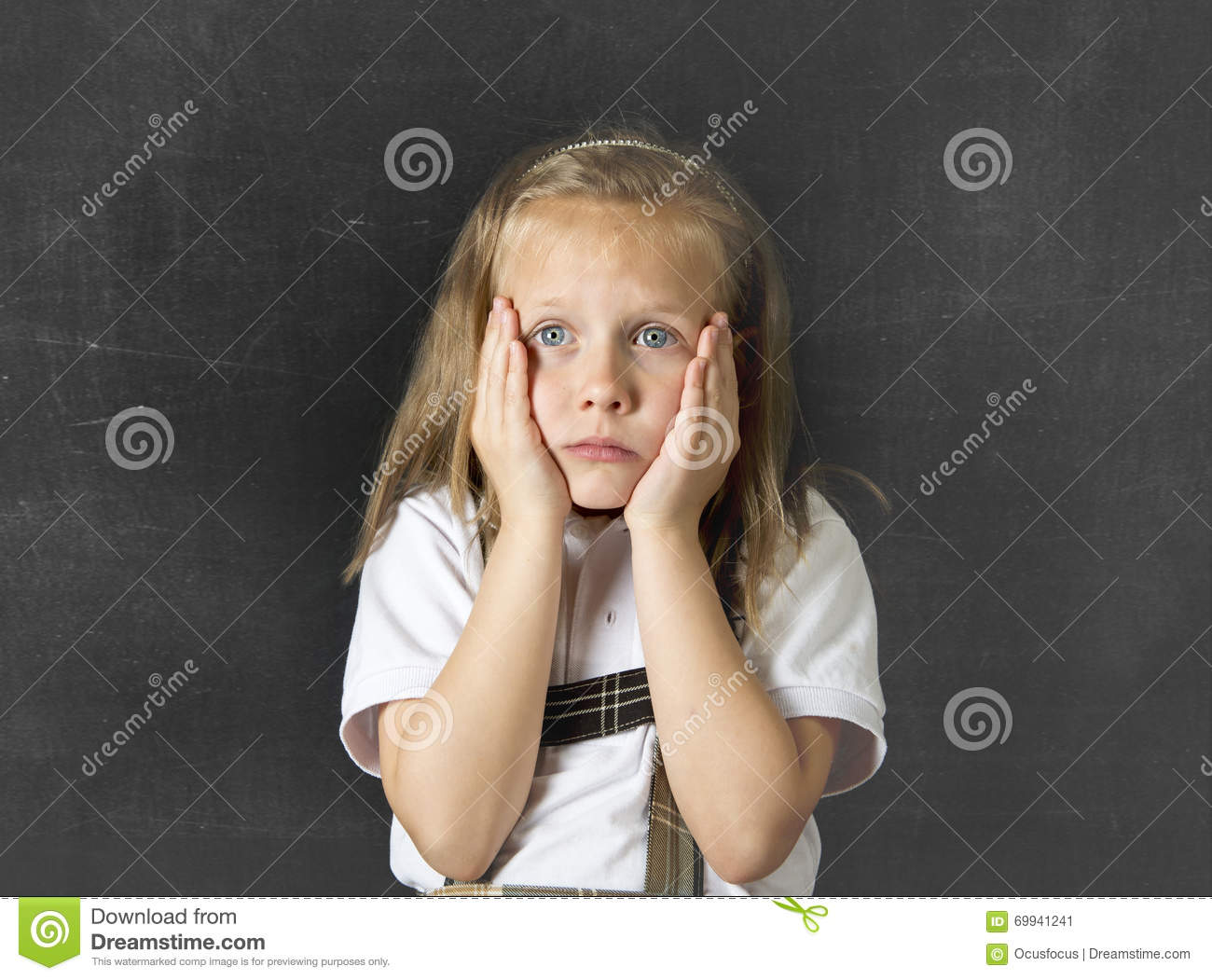 sweet junior schoolgirl crying sad in children education