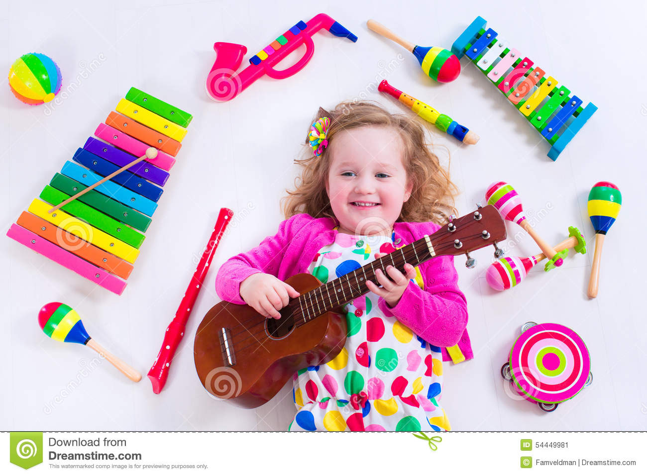 Sweet little girl with music instruments